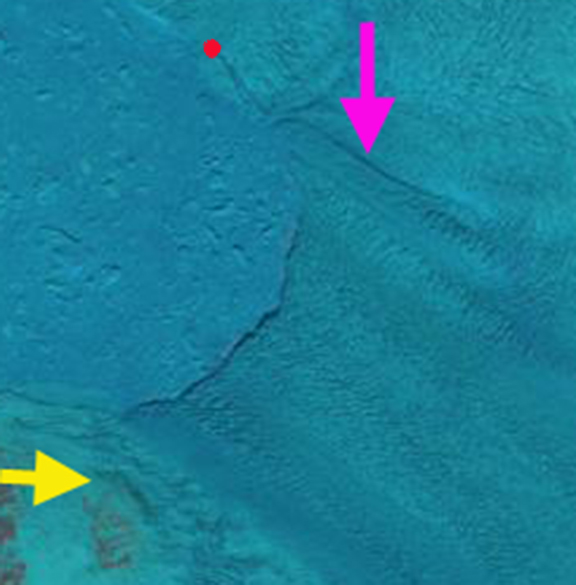 May 9 The pink arrow notes a prominent lateral rift, the yellow arrow a reference point.  Red dot is a transverse rift near the ice front.  No large rifts are apparent in the area of the main calving on May 9.