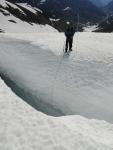 Measuring snow depth in crevasse on Rainbow Glacier