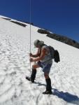 Probing snow depth on Sholes Glacier