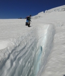Measuring snowpack in crevasse