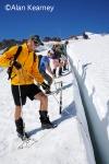 Ben Pelto assessing snow stratigraphy in crevasse